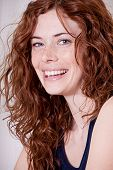 stock photo of freckle face  - beautiful red head woman with freckled face and blue eyes - JPG