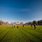 Men Playing Football In Park - Amsterdam