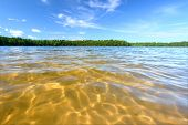 stock photo of legion  - Beautiful swimming beach of a northwoods Wisconsin Lake - JPG