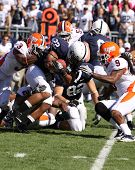 Penn State's Evan Royster #22 is tackled by a host of Illinois players