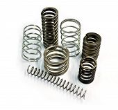picture of amortization  - Photo of metal spring on the white background - JPG