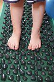 Children Feet Standing On Massage Carpet