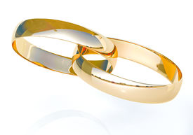 stock photo of glans  - Wedding rings on a light background with reflections - JPG