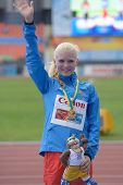DONETSK, UKRAINE - JULY 13: Olga Shargina of Russia win gold medal in 5,000 m race walk during 8th IAAF World Youth Championships in Donetsk, Ukraine on July 13, 2013