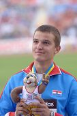 DONETSK, UKRAINE - JULY 13: Matija Greguric of Croatia win gold medal in hammer throw during 8th IAA