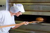 Female baker baking bread