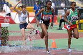 DONETSK, UKRAINE - JULY 12: Op'T'Hoog, France, Jepkemei, Kenya, and Ansa, Ethiopia compete in 2000 m steeplechase during 8th IAAF World Youth Championships in Donetsk, Ukraine on July 12, 2013