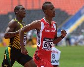 DONETSK, UKRAINE - JULY 12: Jonathan Farinha of Trinidad and Tobago (right) and Odane Bernard of Jamaica compete in 200 m during 8th IAAF World Youth Championships in Donetsk, Ukraine on July 12, 2013
