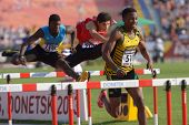 DONETSK, UKRAINE - JULY 12: Hyde, Jamaica (right), Coakley, Bahamas (left), and Monaco, Chile compete in 110 m hurdles during 8th IAAF World Youth Championships in Donetsk, Ukraine on July 12, 2013