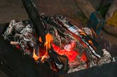 picture of brazier  - Burning wood in old black smoked brazier - JPG