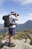 Old Man Photographer On Mountain Top
