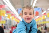 Boy Without Foreteeth In Shop