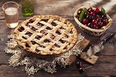 stock photo of cherry pie  - Cherry pie with lattice crust on wooden background