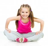 Smiling Little girl gymnast on a white background