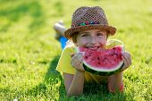 Summer joy - lovely girl eating fresh watermelon in the garden
