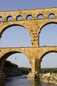 PONT DU GARD, FRANCE - AUGUST 18: A man jumps from the Famous Pont du Gard, Roman aqueduct, on Augus
