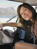 foto of campervan  - Portrait of happy young woman sitting in driver - JPG