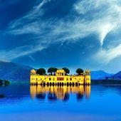 Indian water palace on Jal Mahal lake at night time in Jaipur, India