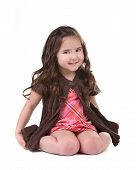 Adorable Young Child Smiling And Sitting On Her Knees