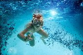 Freedive. Teenager in the mask and snorkel swim underwater.