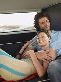 stock photo of campervan  - Loving young couple relaxing in campervan during road trip - JPG