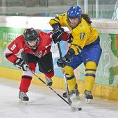 INNSBRUCK, AUSTRIA - JANUARY 22 Anna Johansson (SWE) and Paulina Polczik (AUT) fight for the puck in