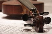 Old violin with note background