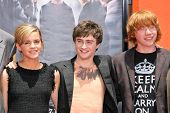 Emma Watson with Daniel Radcliffe and Rupert Grint at the Hand, Foot and Wand Print Ceremony Honoring The Cast of