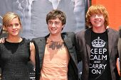 Emma Watson with Daniel Radcliffe and Rupert Grint at the Hand, Foot and Wand Print Ceremony Honorin