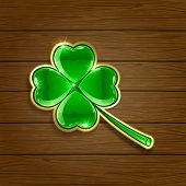 Clover on wooden background