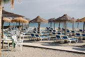 Parasols With Deckchairs On The Beach. Nerja, Spain