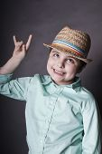 image of misbehaving  - vertical portrait of a naughty boy in a hat concept of misbehave - JPG