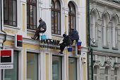 MOSCOW, RUSSIA, CIRCA 2012 - Industry alpinists clean building facade circa 2012 in Moscow, Russia