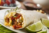 stock photo of scrambled eggs  - Hearty Chorizo Breakfast Burrito with Eggs Cheese and Hashbrowns