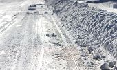 stock photo of plowing  - A side view of a snow plowed avenue - JPG