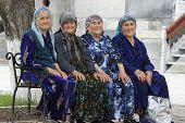 Four old woman sitting on a bench, Samarkand, Uzbekistan