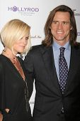 Jenny McCarthy and Jim Carrey at the DESIGNCARE 2007 Fundraiser to benefit those battling debilitating disease and life circumstances. Private Residence, Malibu, CA. 07-21-07