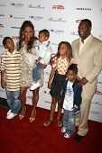 Rodney Peete and Holly Robinson Peete with family at the DESIGNCARE 2007 Fundraiser to benefit those battling debilitating disease and life circumstances. Private Residence, Malibu, CA. 07-21-07