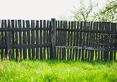 Old Rural Wooden Fence Near Freshness Green Grass