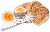 Breakfast Egg With Croissant On White
