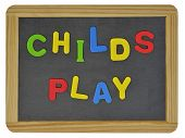 Childs play written on traditional school slate