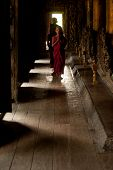 Three Young Monks Walking At Shwenandaw Monastery In Mandalay,Myanmar.
