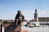 Chimneysweep Monument On The Roof In The Lviv, Ukraine.