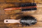 Wooden hairbrushes on wooden background