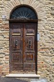 Old Wooden Door In A Stone House Italian