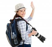 young tourist waving good bye isolated on white