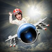 image of fighter plane  - Happy little pilot flying in retro jet fighter - JPG