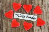 Happy birthday card with red heart shaped jelly sweets