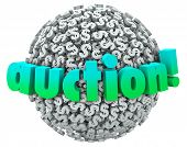 picture of bartering  - Auction word on a ball or sphere of dollar signs or symbols as a winning bidder buys  - JPG