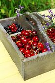 Fresh berries in wooden box, close up